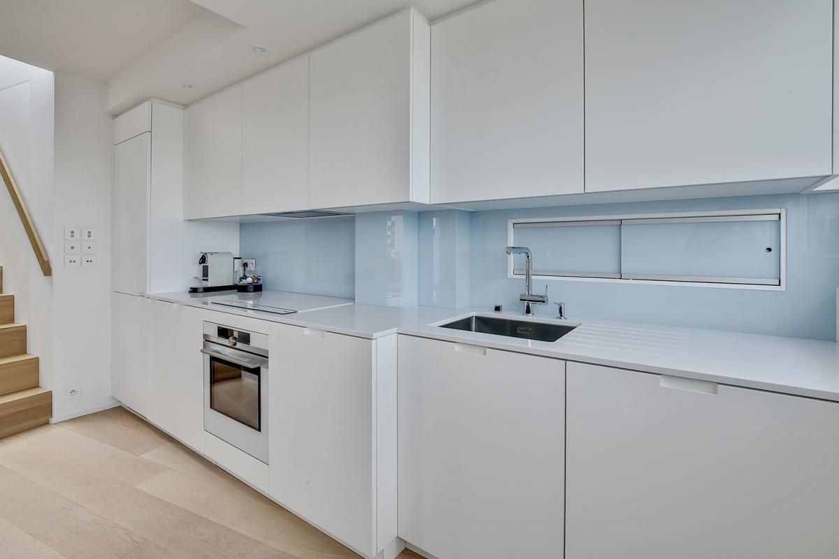 Réaménagement d'un appartement à Paris et création d'un rooftop : cuisine architecte interieur