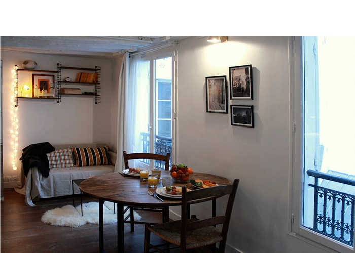 Studio 22m²_Paris 4ème : vue coin repas et séjour