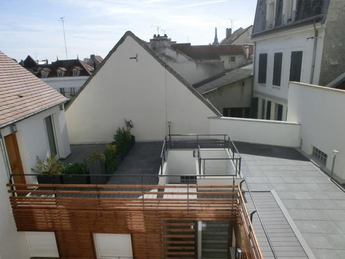 Réhabilitation, extension et surélévation d'un immeuble insalubre - Meaux : 01.Photo réalisé 4