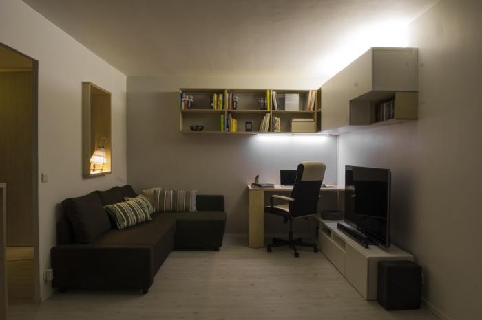 Rénovation d'un appartement, axé sur la pièce à vivre.